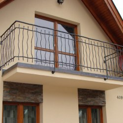 A hand forged balcony railing - country style