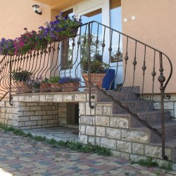 A wrought iron railing - log