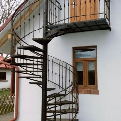 A wrought iron spiral railing - a cottage