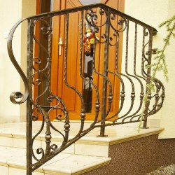 A wrought iron staircase handrail