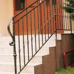 A wrought iron staircase handrail - house entrance