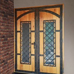 A wrought iron door with wood