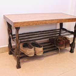 A hand forged shoe rack - wrought iron furniture