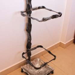 A wrought iron umbrella stand