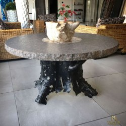 An exclusive forged table of a tree bark design