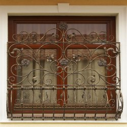 A decorative wrought iron grille