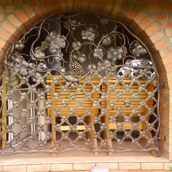 A fixed wrought iron grille