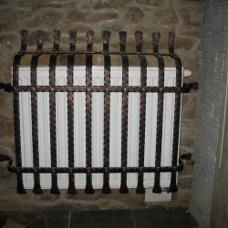 A wrought iron radiator cover