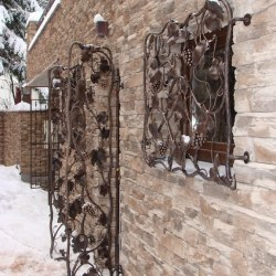 Artistic wrought iron grilles in a wine cellar