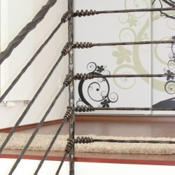 A forged stair railing - Knot pattern