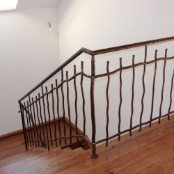A hand forged railing - interior - stairs