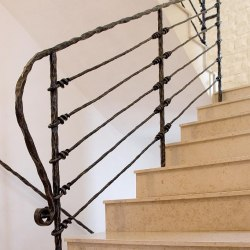 A hand forged stair railing - Knot pattern
