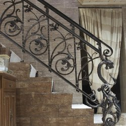 A hand wrought iron railing - Interior handrails