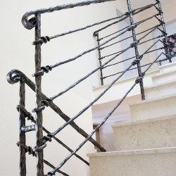 A luxury wrought iron stair railing - Knot pattern