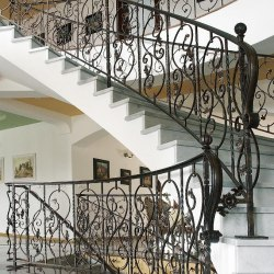 A spiral wrought iron railing - Interior handrails