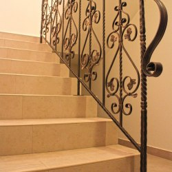 A wrought iron interior railing in a historical style