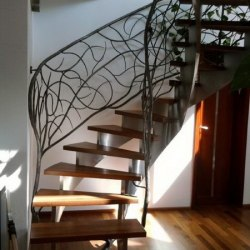 A wrought iron polished railing - Interior handrails