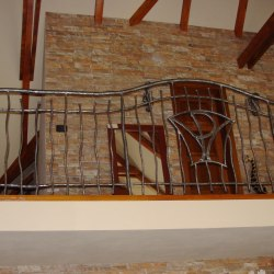 A wrought iron railing - interior - stairs
