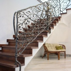 Exclusive hand wrought iron interior staircase railing