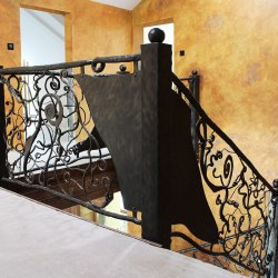 Hand forged interior staircase railing - Roots