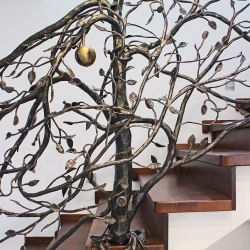 Hand wrought iron interior staircase railing - a tree
