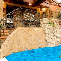A hand wrought iron railing - roots