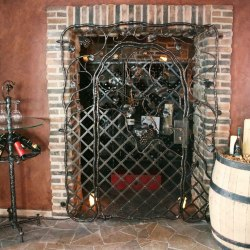 A wrought iron grille in a wine cellar