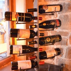 A wrought iron rack - wine holder